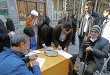 "Photo of ايرانيون يستذكرون ""الجنرال الشهيد"" أثناء التصويت في الانتخابات"